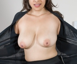 Amateur model Anastasia Cherry uncovers big natural breasts before baring bush