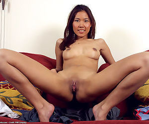 Asian first timer Luxi revealing tiny tits and near hairless vagina