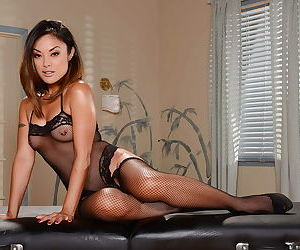 Asian babe Kaylani Lei poses naked with shaved pussy on the table