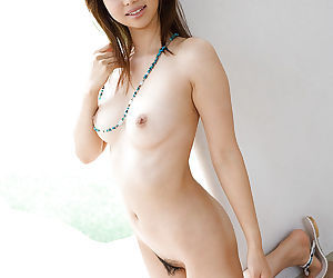 Cute asian tot Yura Aikawa stripping with the addition of exposing her off colour body