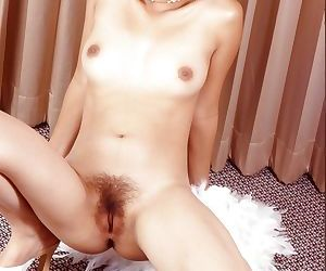 Brunette Asian spreads her legs and demonstrates her hairy pussy