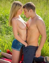 Hot blonde teen gets her bald twat hammered outdoors in a field