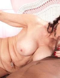 Nude older woman Rita Daniels sucks off a big black dick with ease