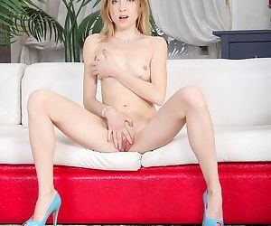 Young amateur Isabel Stern strips down to high heels before masturbating