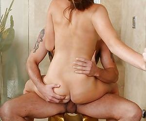 Graceful redhead masseuse gives a sensual handjob and gets cocked up