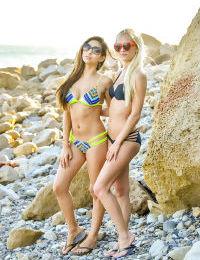 Teen lesbians in bikinis flash their tits and asses at the beach