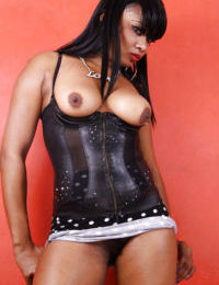Tasty mature ebony Strawberry shows her natural tits and spankable ass