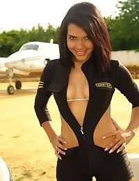 Sexy Latina amateur Vivi Spice shows off her perky tits at an airfield