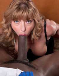 Mature babe grinds on a huge choco dick in the office and enjoys it in mouth