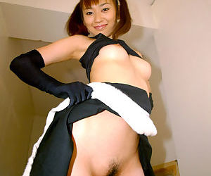 Seductive asian cheerleader uncovering her tiny tits and hairy cunt