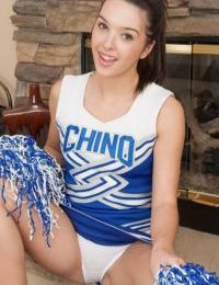 Teen cheerleader Jaslene Jade removes uniform and cotton panties to pose naked