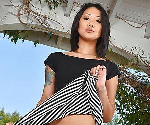 Asian first timer Saya Song displaying hairy cunt on chair in backyard