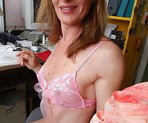 Mature office worker Linda pulling panties aside to bare hairy cunt