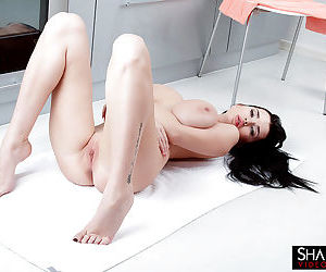European centerfold babe Sha Rizel flaunting huge hooters and shaved vagina