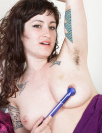 Mature hirsute model Stacey Stax showing off hairy underarms