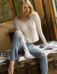 Clothed teen babe Blake Bartelli sliding ripped denim jeans over sexy legs