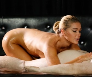 Blonde with small tits oils up her guy for a massage before riding his cock