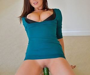 Clothed girl next door parks her tight pussy on top of a cucumber
