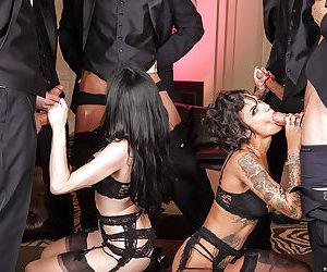 Glamorous brunette sluts in stockings enjoys a fervent gangbang action