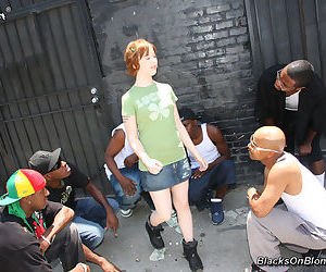 Redheaded emo chick Julie Ellis tries fucking 2 black men at the same time