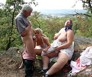 Grandma and grandpa pick up a young girl for a threesome in the woods