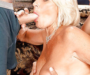 Hot granny Georgette Parks sucking off 2 guys wearing red hot linergie
