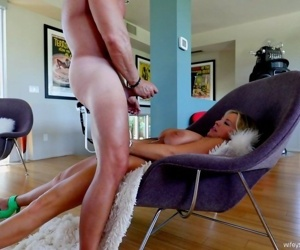 Sandra Otterson kneels before cock and sucks it until the last drop of sperm