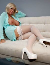 Naughty mature doxy in white stockings revealing her gorgeous tits