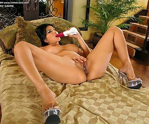 Brunette Indian Sunny Leone with big tits spreading legs & toying with dildo