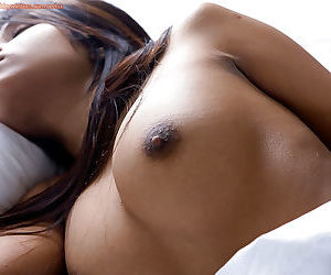 Indian babe Kiki exposes her big natural tits and hairy pussy