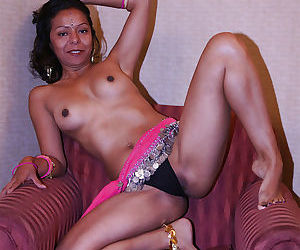 Lecherous indian lady revealing her small tits and pussy