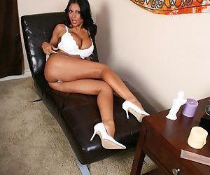 Sexy Indian MILF Priya Anjeli Rai is posing naked with her cunt spread
