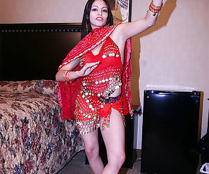 Foxy indian chick with slender legs uncovering her tiny tits
