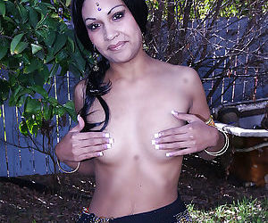Naughty indian ladie on high heels revealing her nice tits outdoor