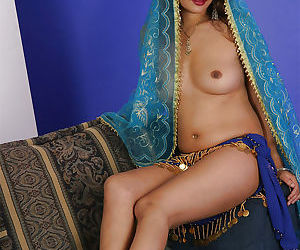 Sexy indian babe on high heels slowly uncovering her tempting curves