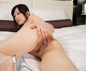Sweet young Asian girls share a hard cock between them POV style