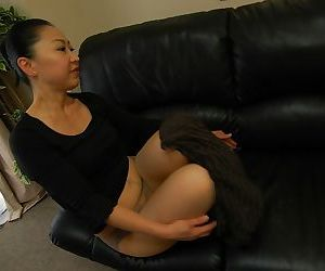 Asian MILF Naoko Yamaguchi undressing and demonstrating her pussy in close up