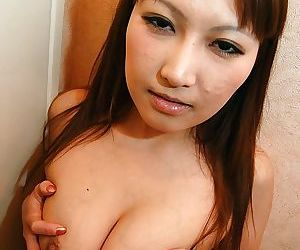 Asian babe Orie Okano undressing and exposing her soaking pussy in close up