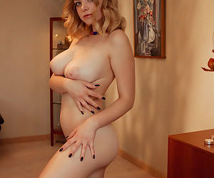 Young solo girl Daniel Sea uncovers her nice tits and shaved pussy
