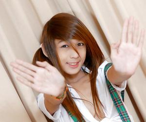 Barefoot Oriental schoolgirl Nutty lifts short skirt to jerk lady-boy shlong
