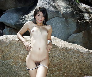 Small tit Asian tranny showcasing her big ass and hairy cock outdoors