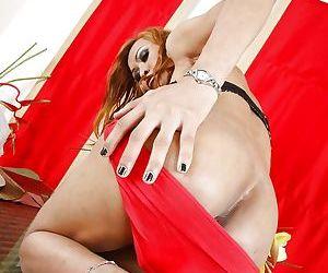 Redhead Asian ladyboy Anne sucking two hard cocks in a nasty threesome