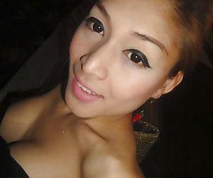 Gorgeous big tit Asian ladyboy Yoyo posing in public before masturbating