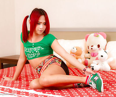 Redhead Asian Ladyboy Nam jacking off teen cock in socks and pigtails