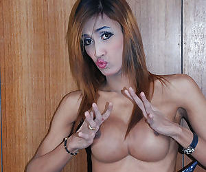 Skinny Asian shemale Icey exposing big boobs while modeling solo