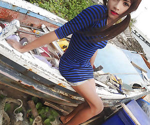Cute teen brunette Asian tranny Un posing and showing off her long legs