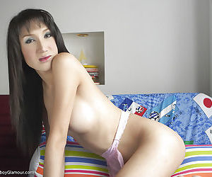 Sexy Asian tranny Gisele jerking off her hairy uncut shecock