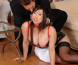 Young Asian Kathia Nobili in latex maid uniform showing huge nipples tied up