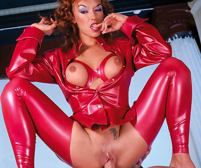 Kinky redhead in red latex outfit plays freaky sex games and does anal sex too