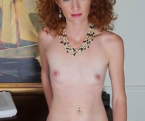 Sweetie with nice-looking red lips stretch her lovely vagina!